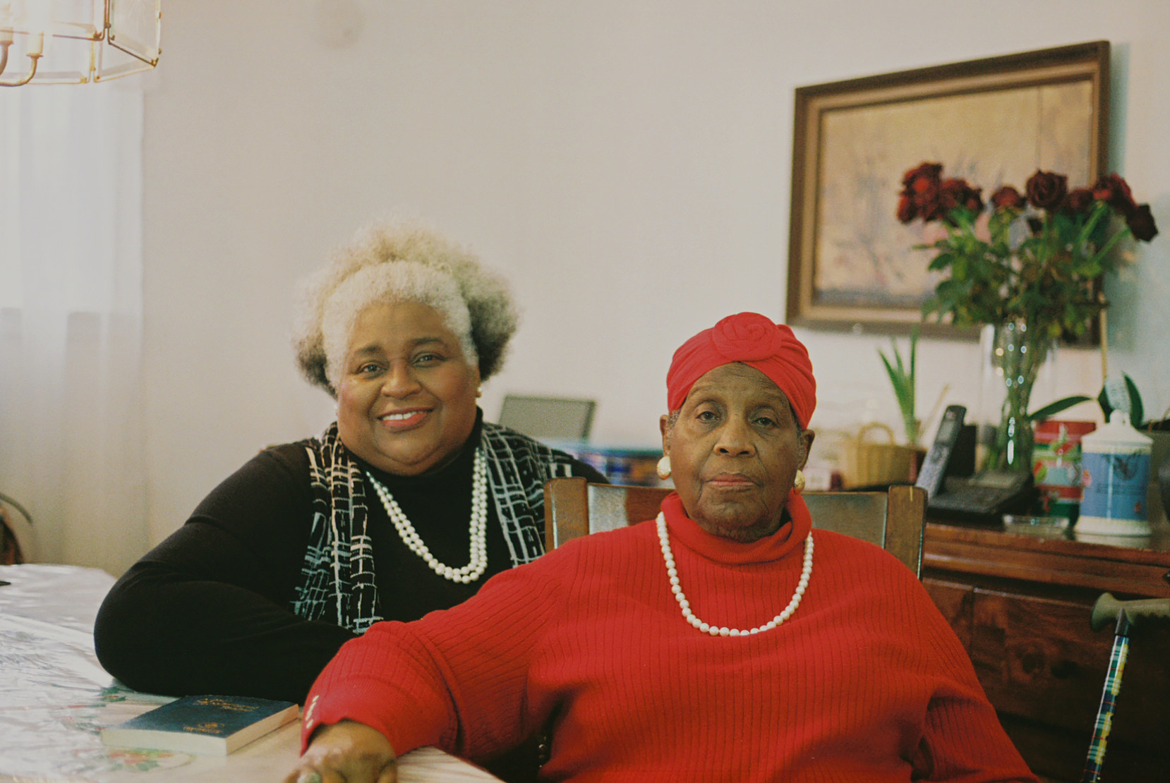 Two older women at a dining room table