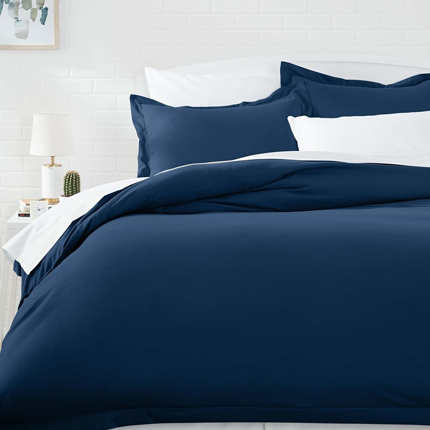 A blue microfiber duvet cover on a bed