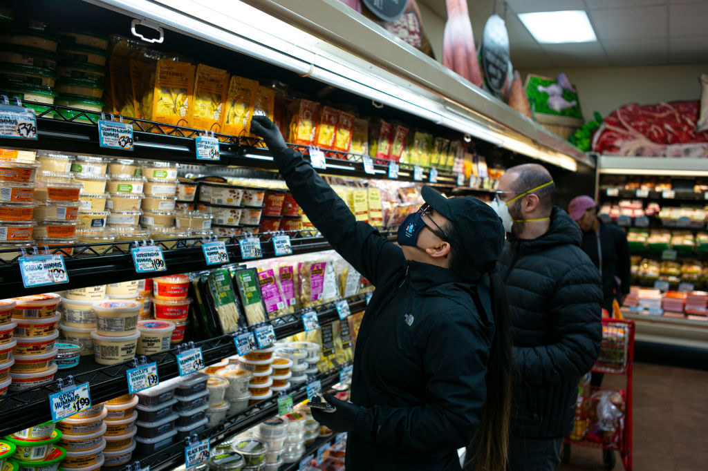 Masked customers shopping in a grocery store