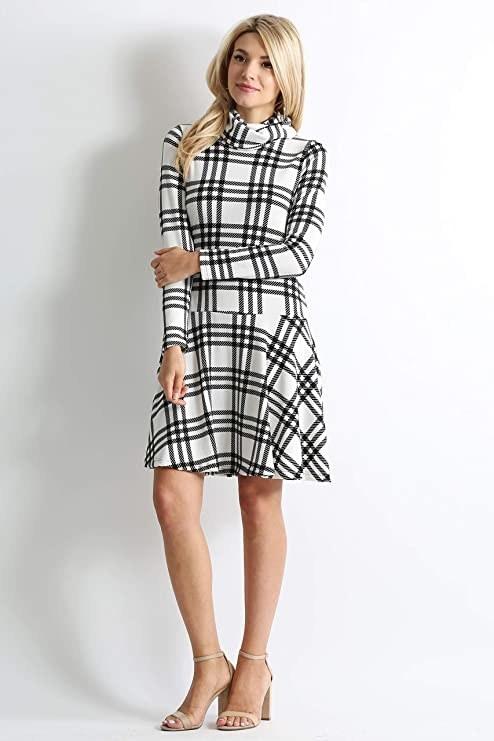 model wearing black and white plaid dress