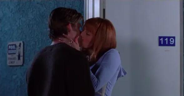 Julie and Luke kissing outside motel