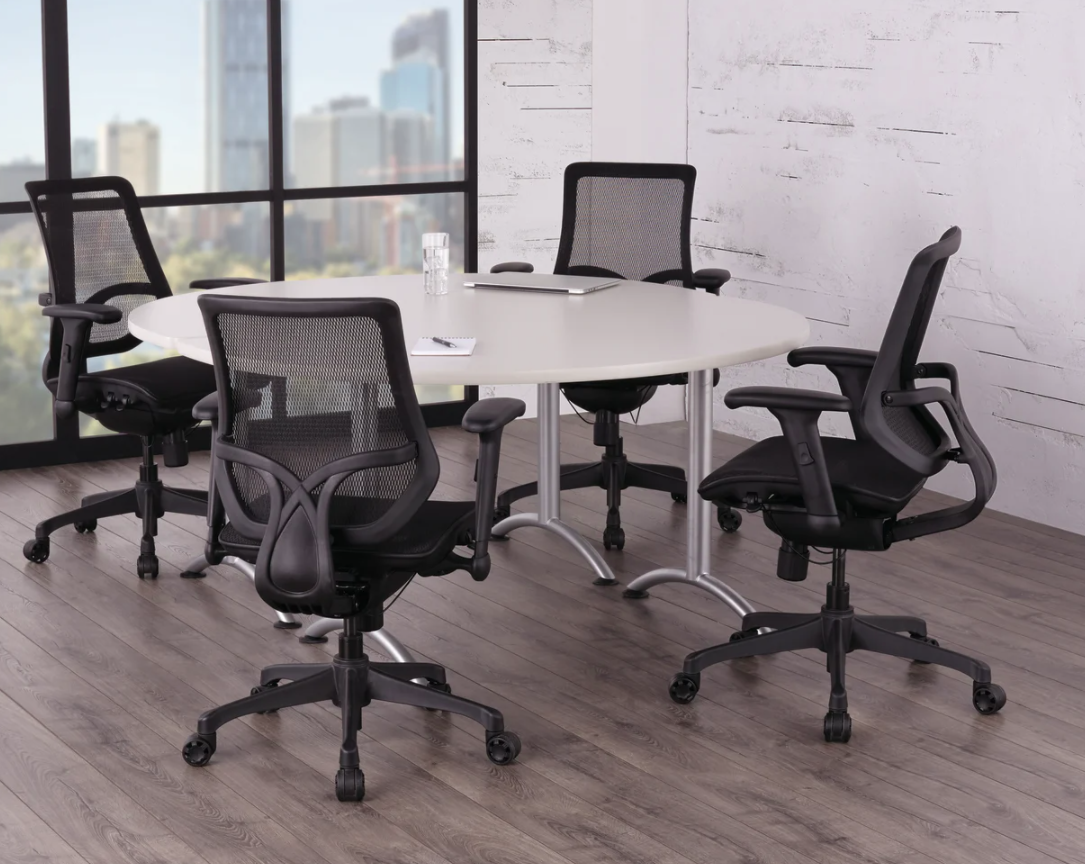 four of the task chairs at a table in an office