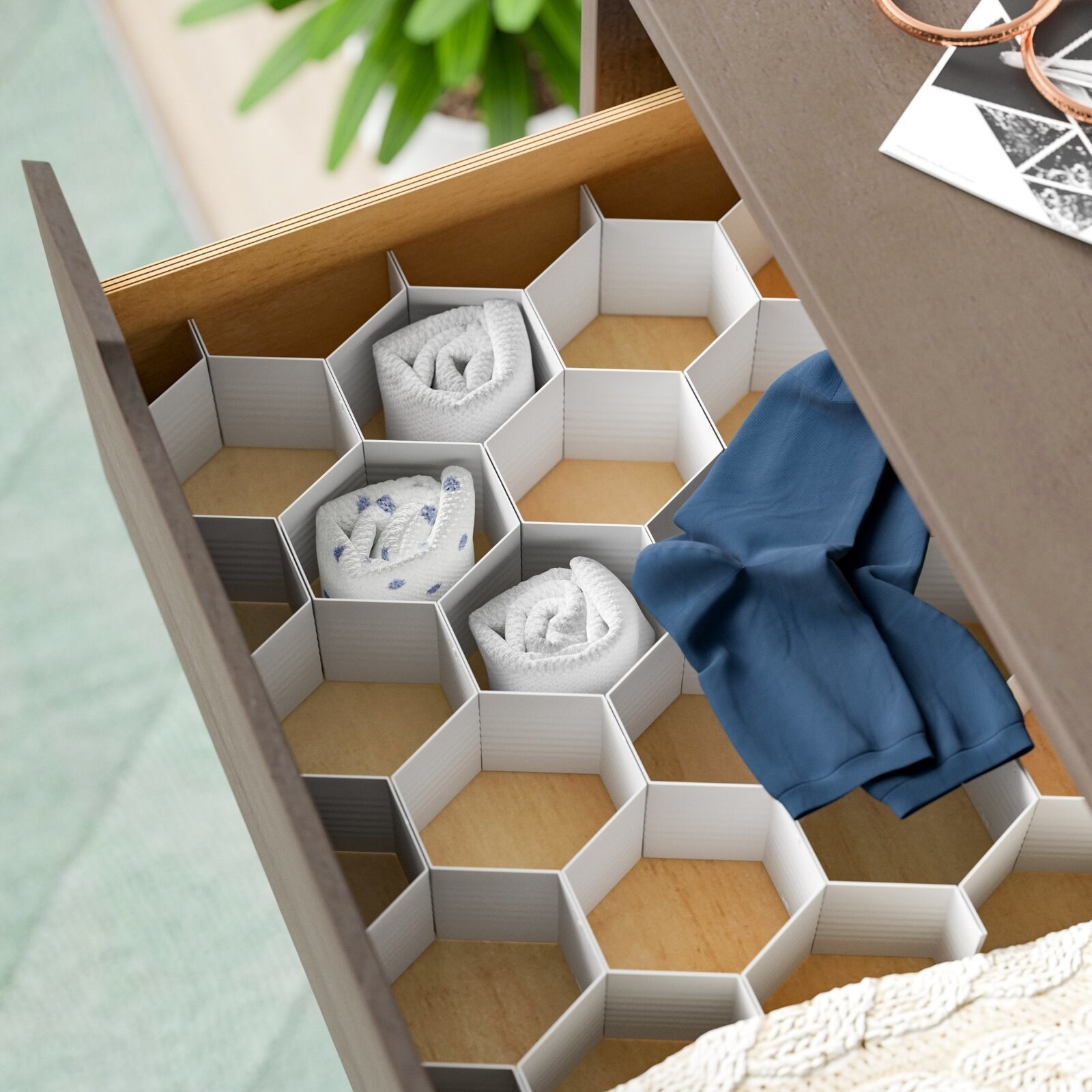 top view of a honeycomb organizer in a drawer