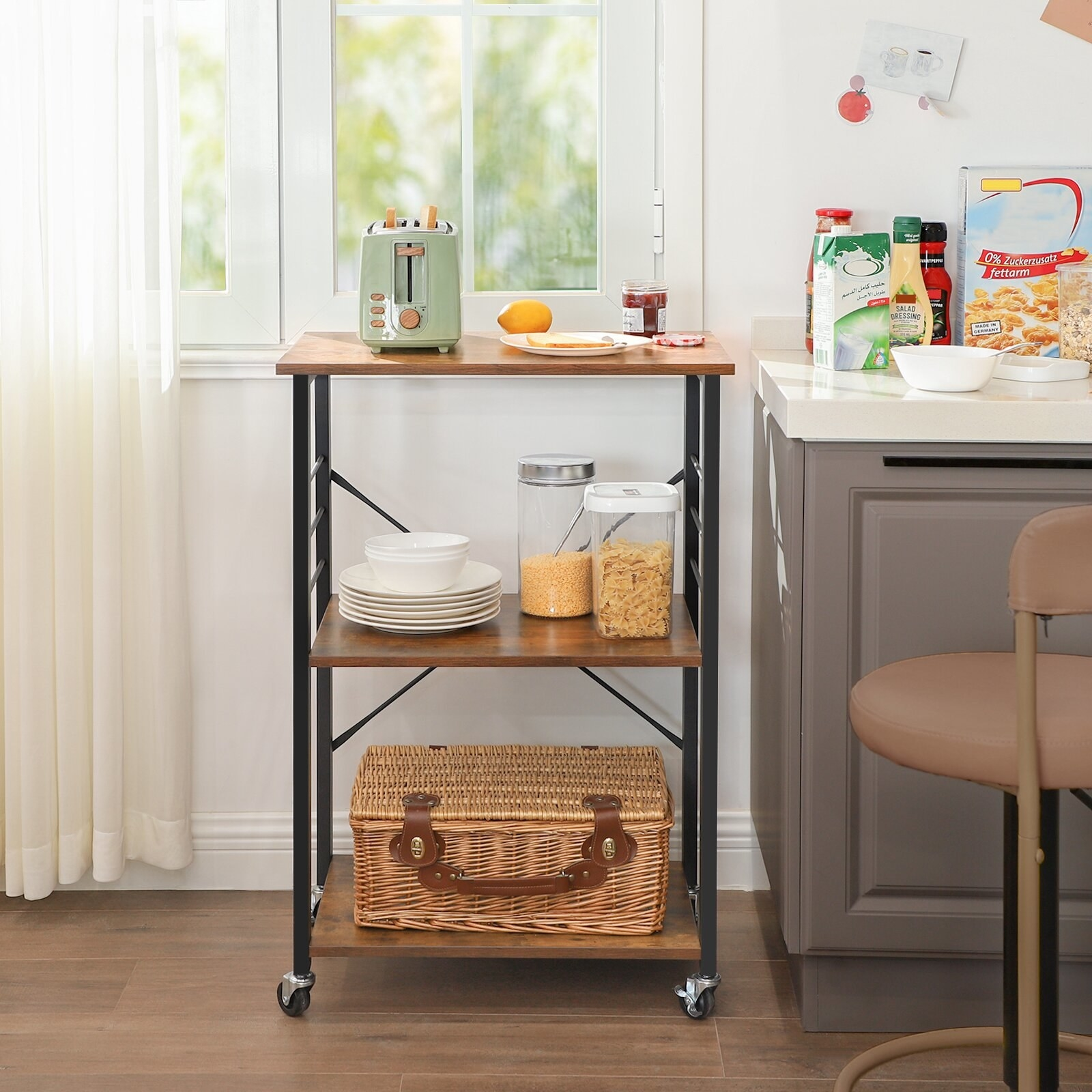 black and wooden rolling kitchen cart with things on it