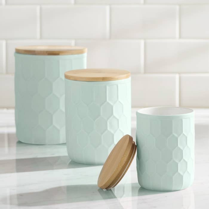 mint green kitchen containers with a honeycomb texture on the outside