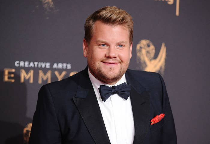 James Corden posing in a tux at the Creative Emmy awards show