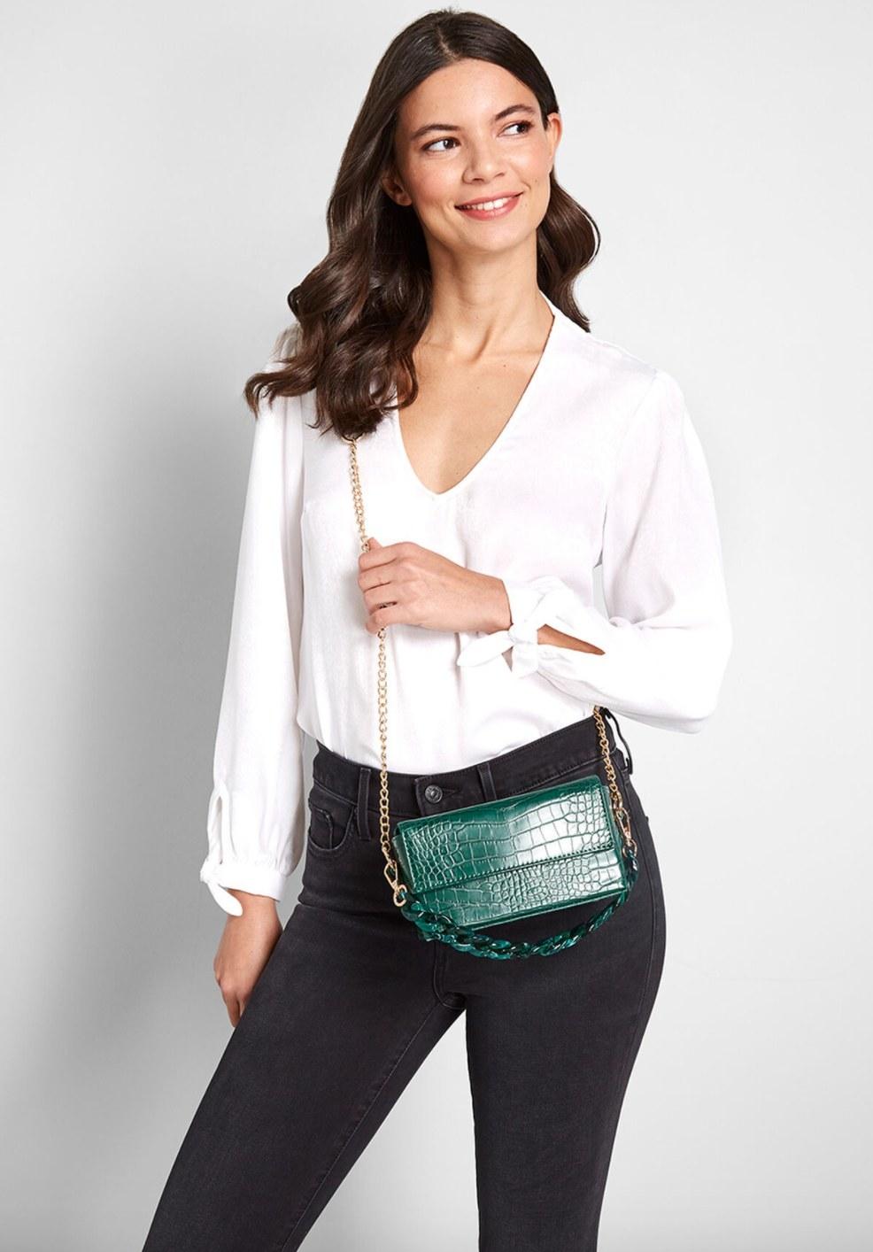 The hunter green purse/ clutch