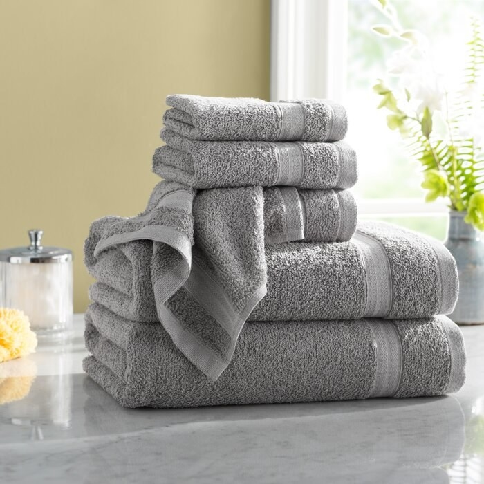 gray cotton towels folded up on a counter