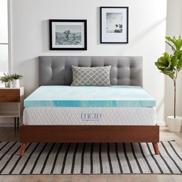 light blue gel mattress topper on top of a white mattress