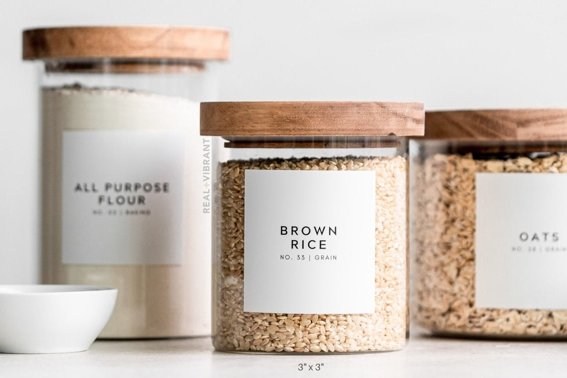 The labels on containers of flour, brown rice, and oats