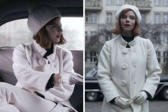 Beth dressed in a long white overcoat and a white hat with a pompom