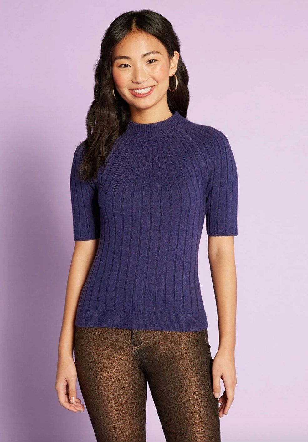 The mock neck sweater in blue