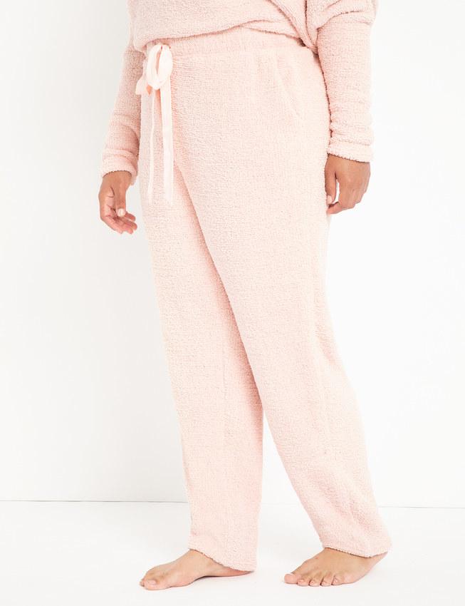 model wears pink plush joggers