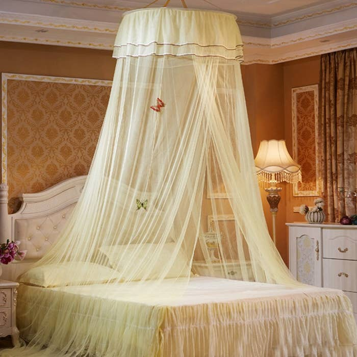 The canopy hung from the ceiling and covering the bed