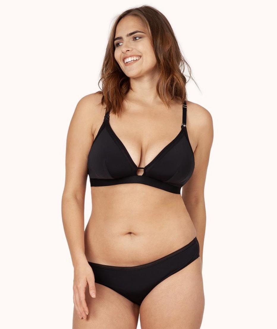 Model in a black adjustable strap bra with keyhole detail