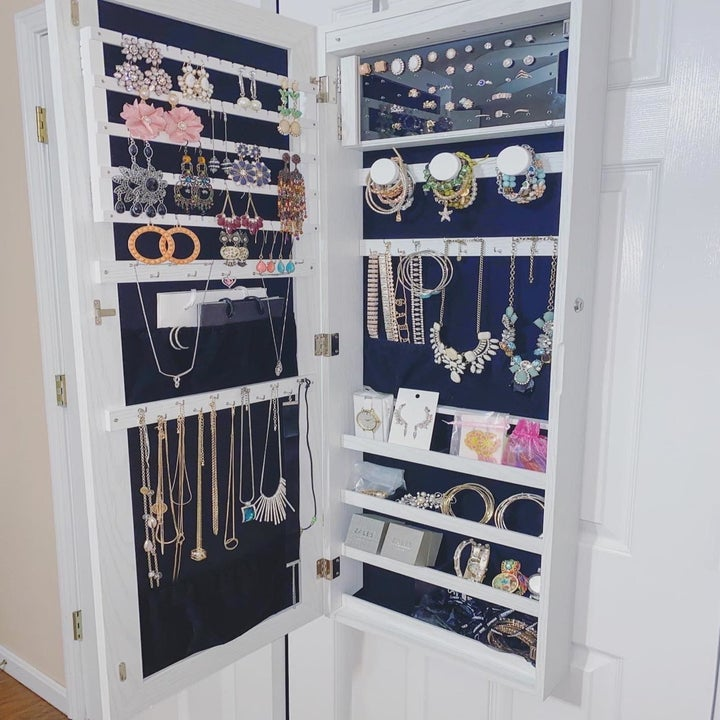 A reviewer photo of the open cabinet filled with lots of jewelry