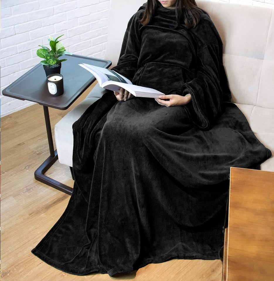 The blanket robe worn by a model sitting and reading