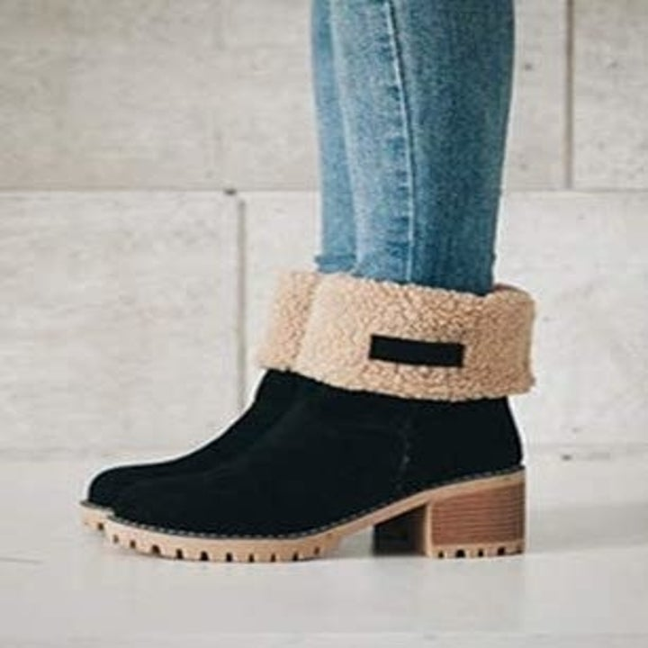 The black suede boot with the top turned over revealing the sherpa insides