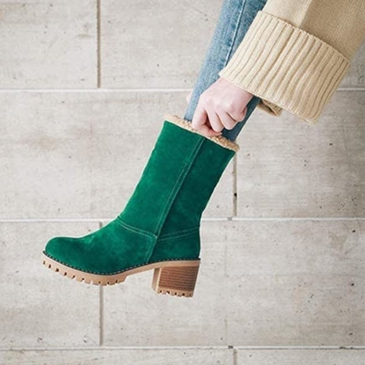 The green suede boot with it fully turned up to the mid-calf height