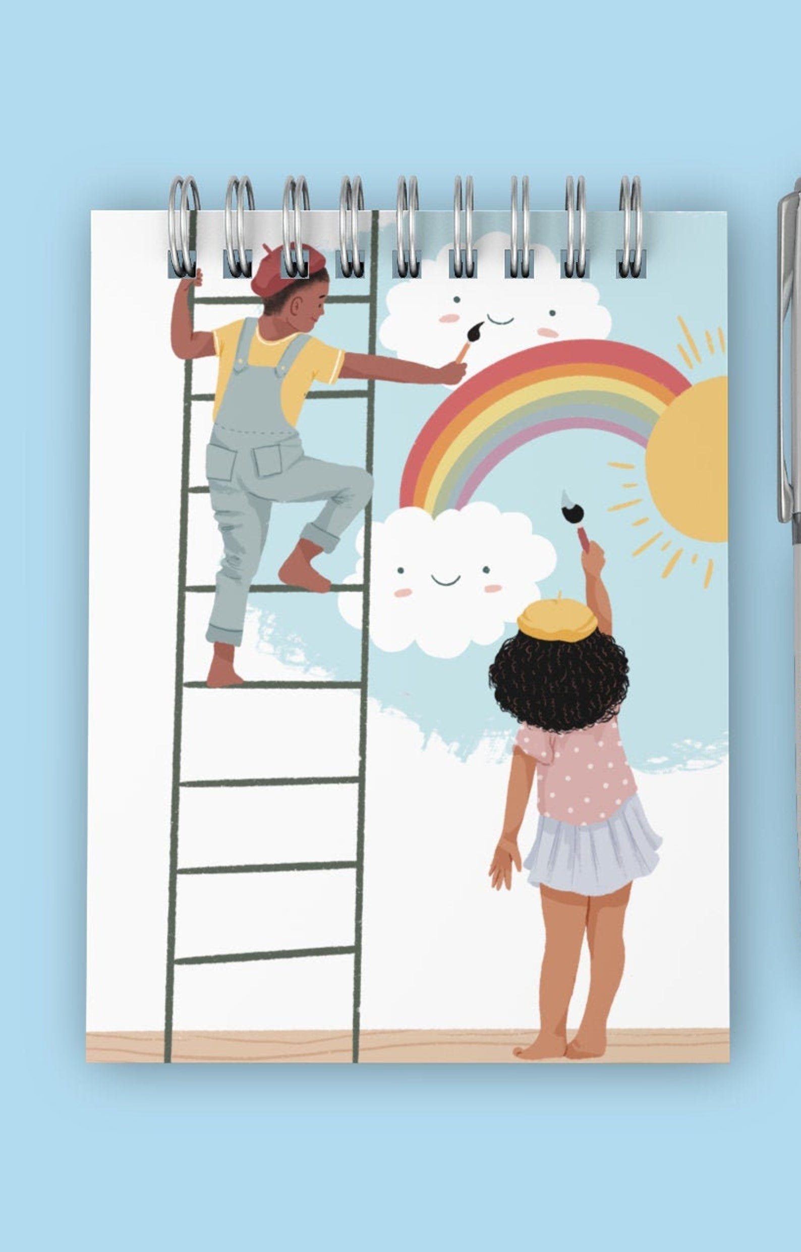 Doodle pad with print of children painting on a wall