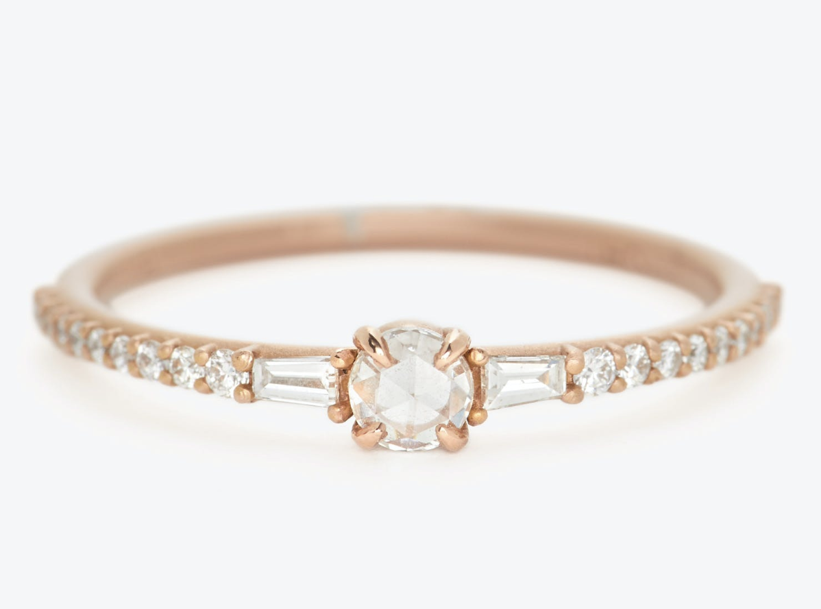 the gold band with a larger diamond center and smaller diamonds throughout