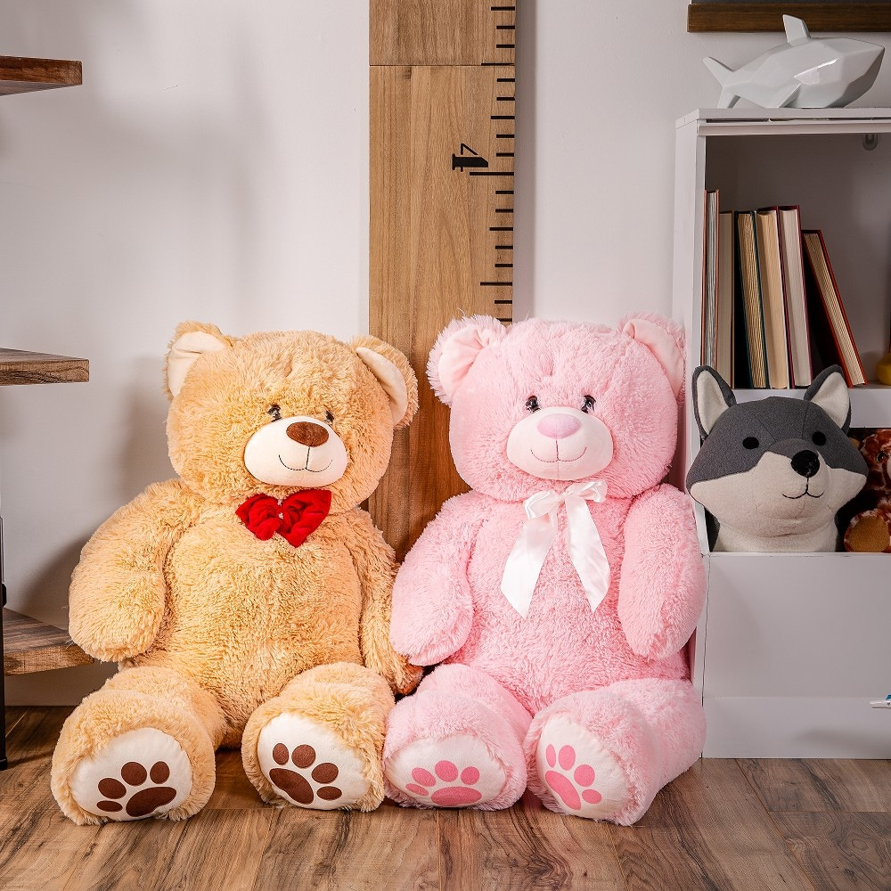 Two of the bears, one in brown and one in pink