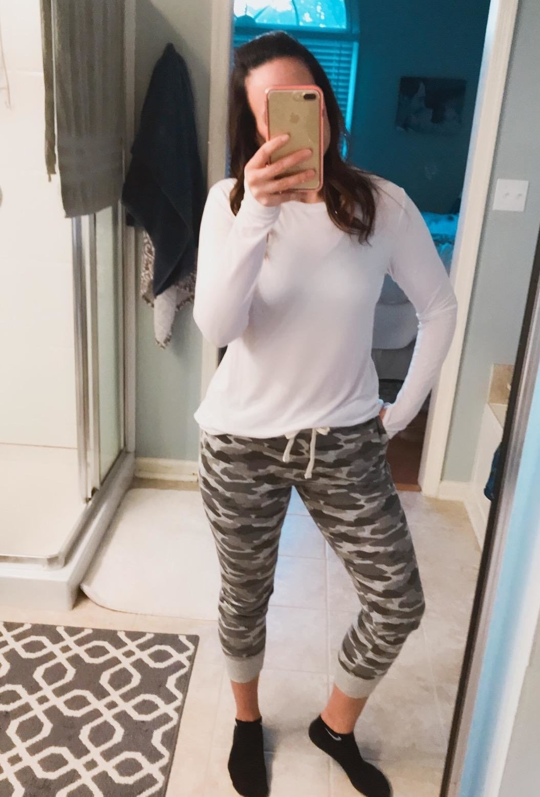 Reviewer wearing the green camo joggers