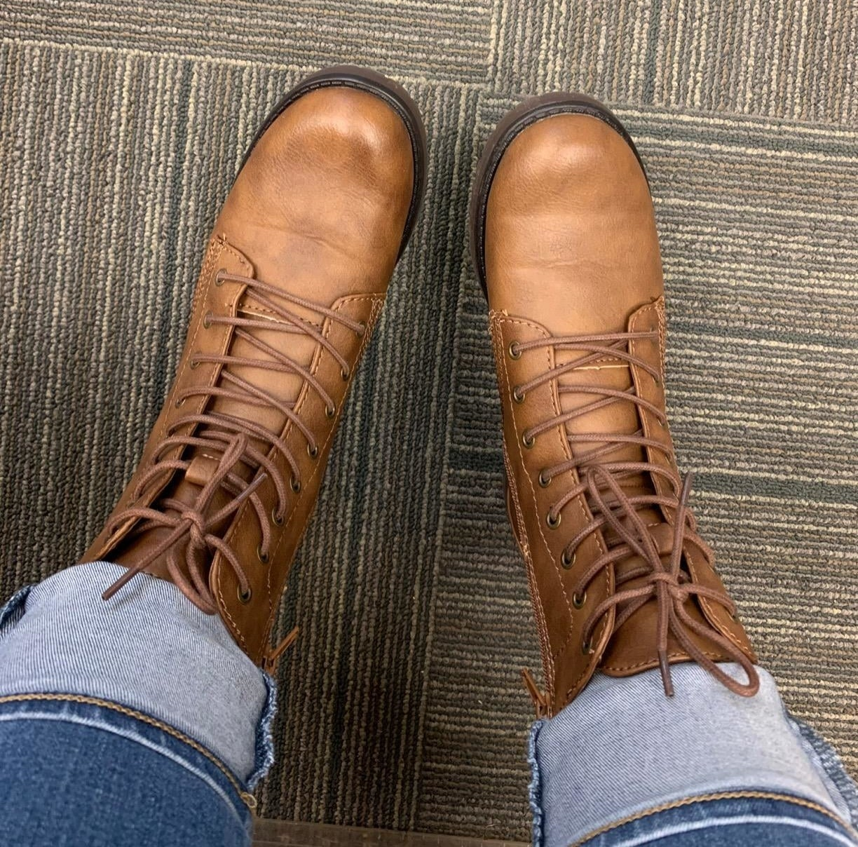 Reviewer wearing the cognac boots