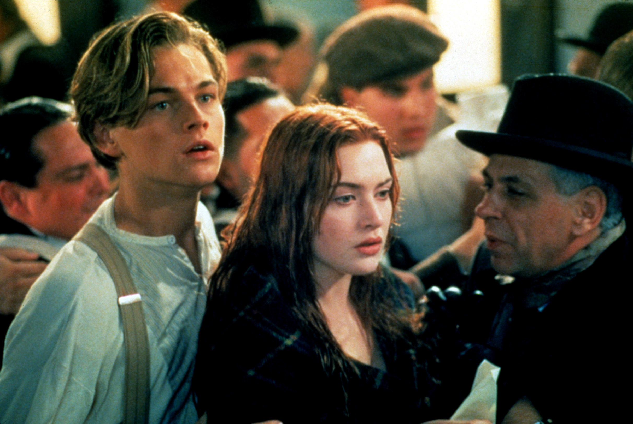 Leonardo DiCaprio and Kate Winslet in line for the lifeboats in the film Titanic