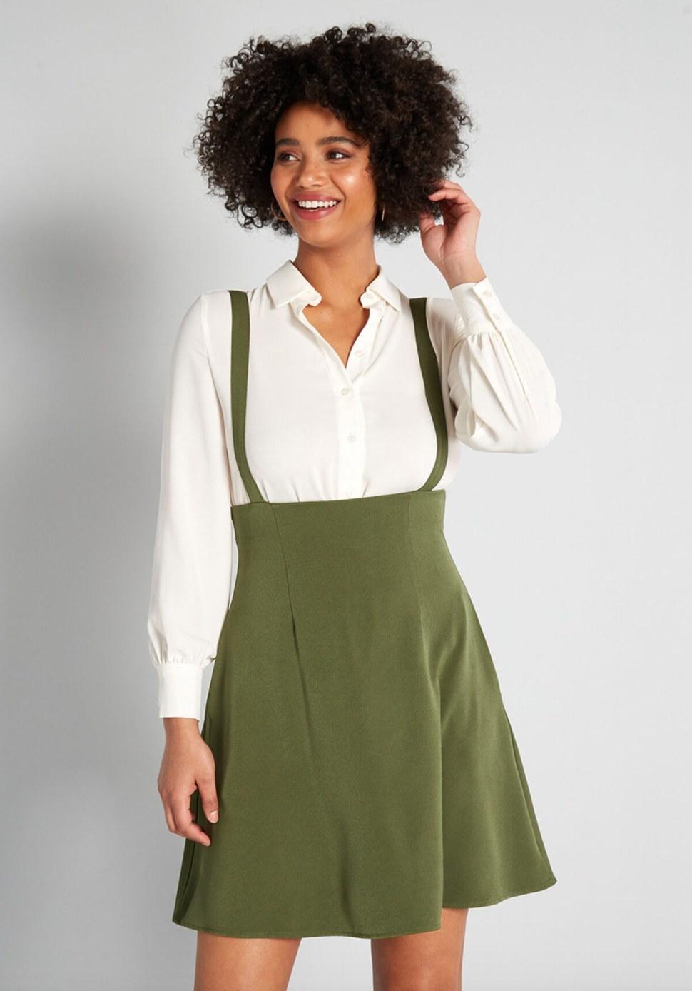 Model wearing the jumper dress in green