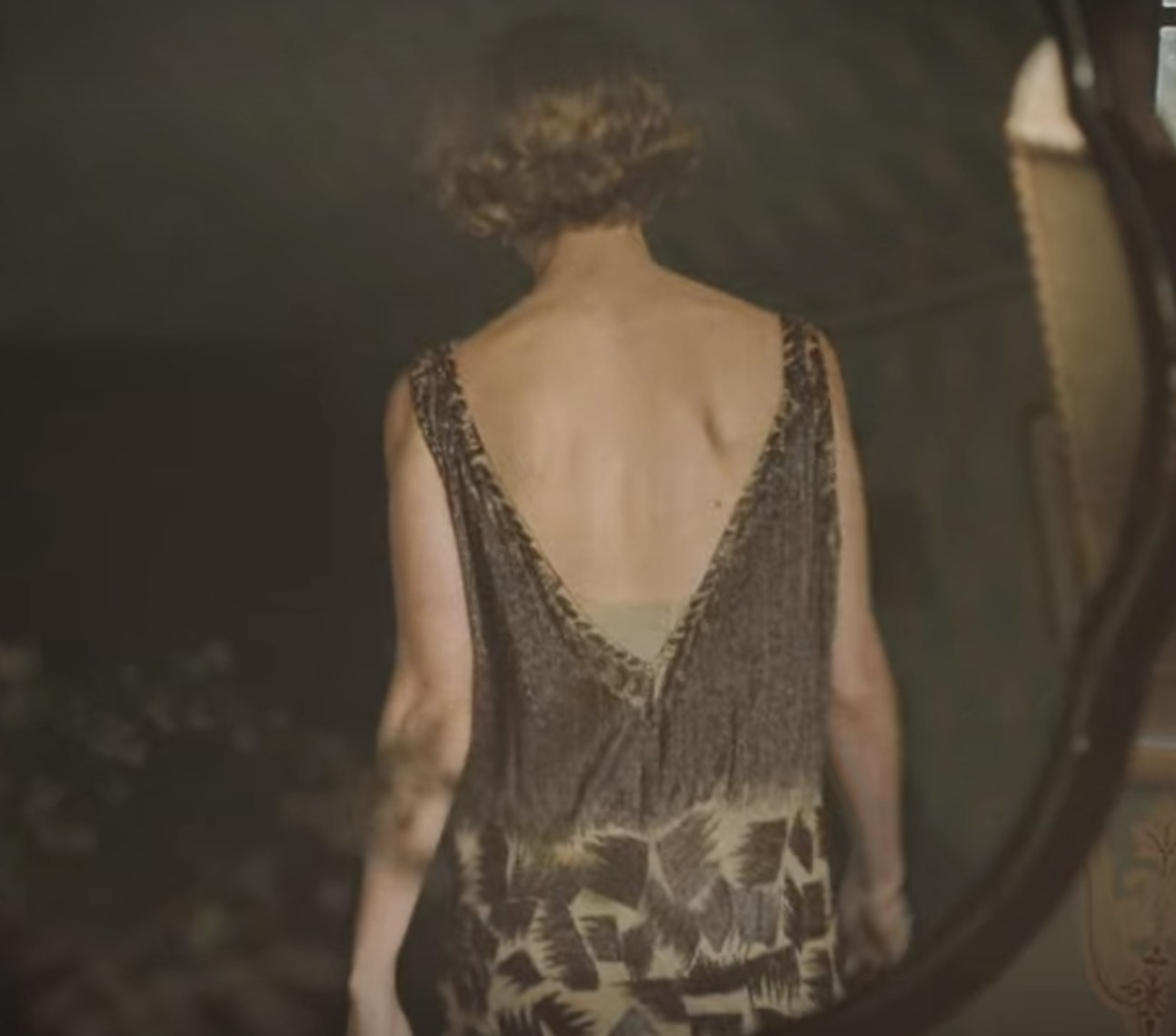 Still from The Dig: Back shot of Mrs. Pretty in gown
