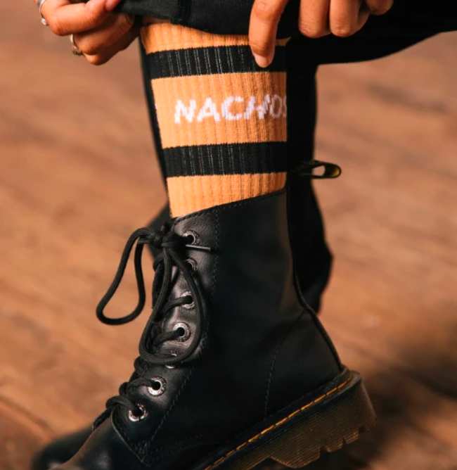 A person pulling up the nacho socks