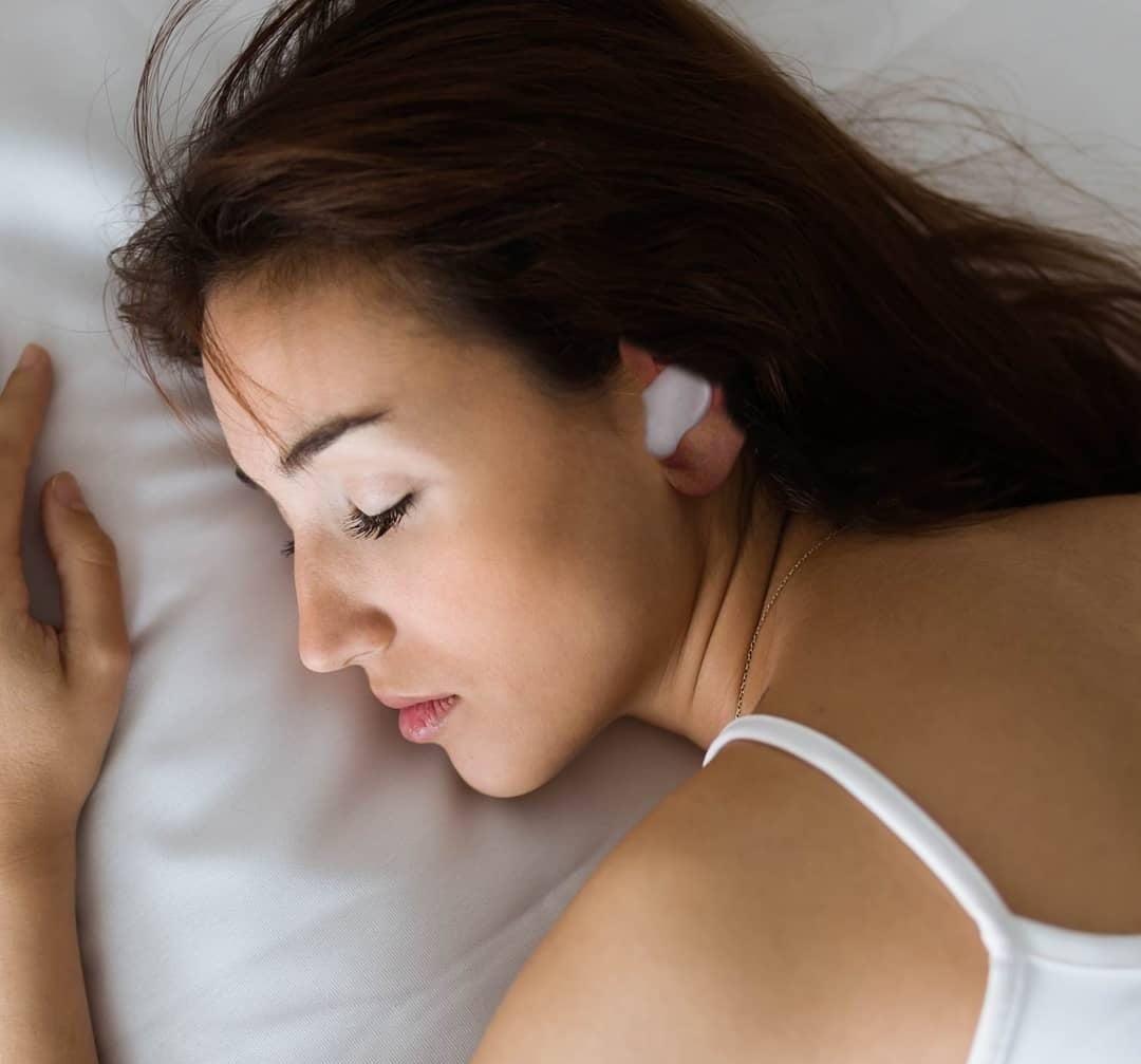 The earplugs worn by a sleeping model