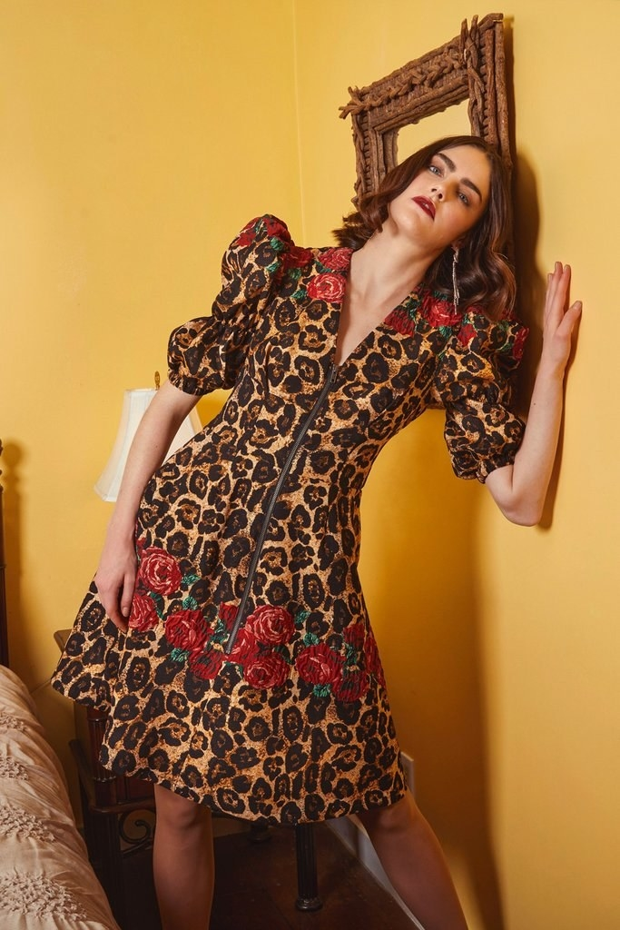 The puff-sleeve flared leopard dress with a V-neck and exposed front zipper detail