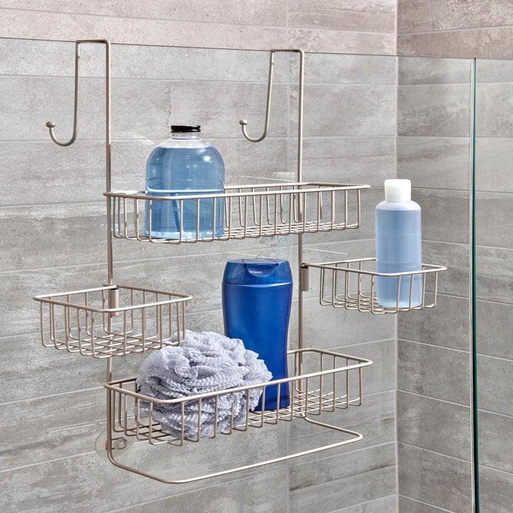 the satin InterDesign Metalo Over Door Shower Caddy hanging from a shower door