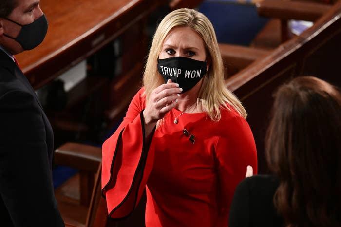 "Rep. Marjorie Taylor Greene, R-Ga., wears a ""Trump Won"" face mask"
