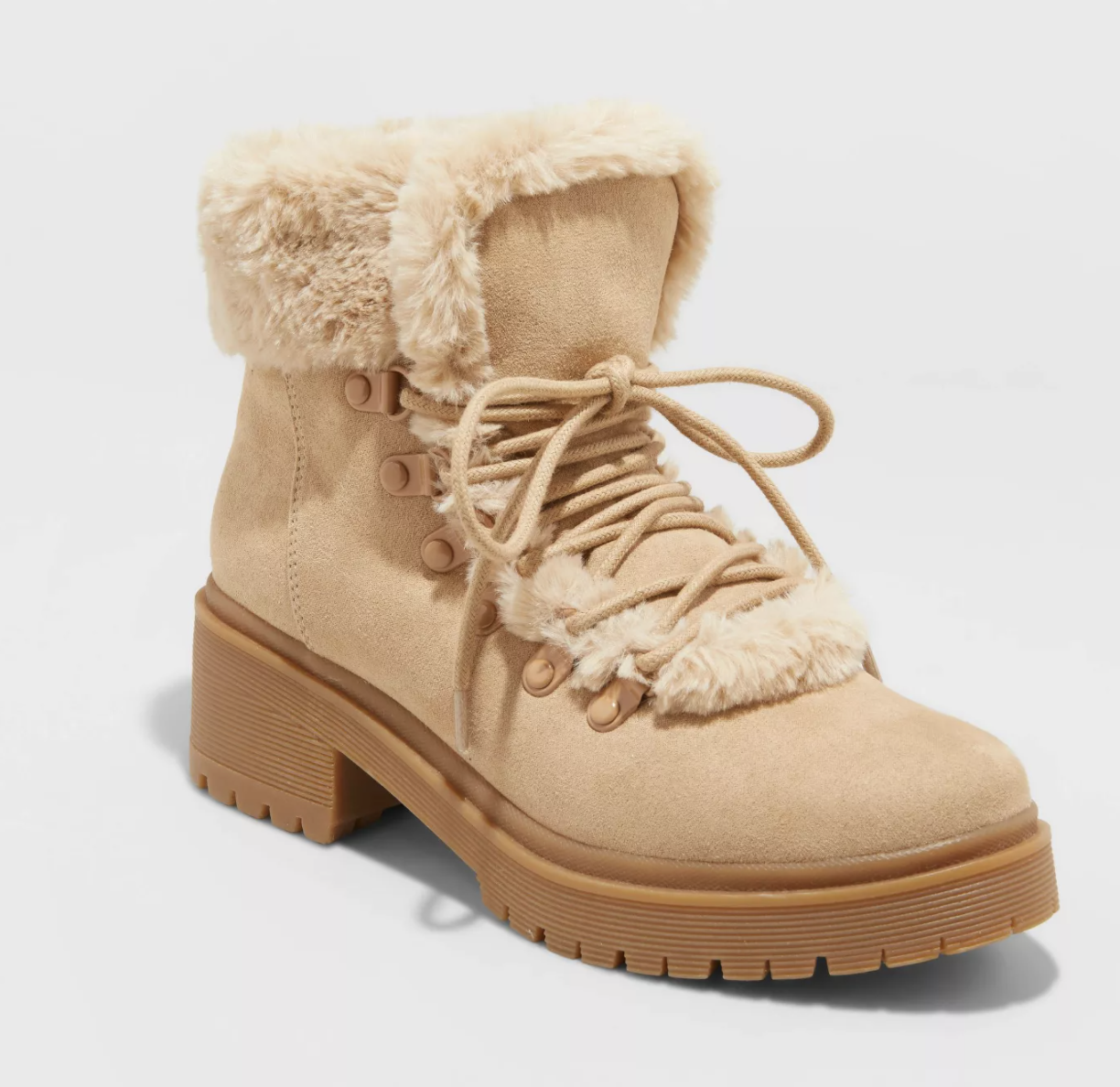 The lace-up furry tan suede boots with a thick rubber sole