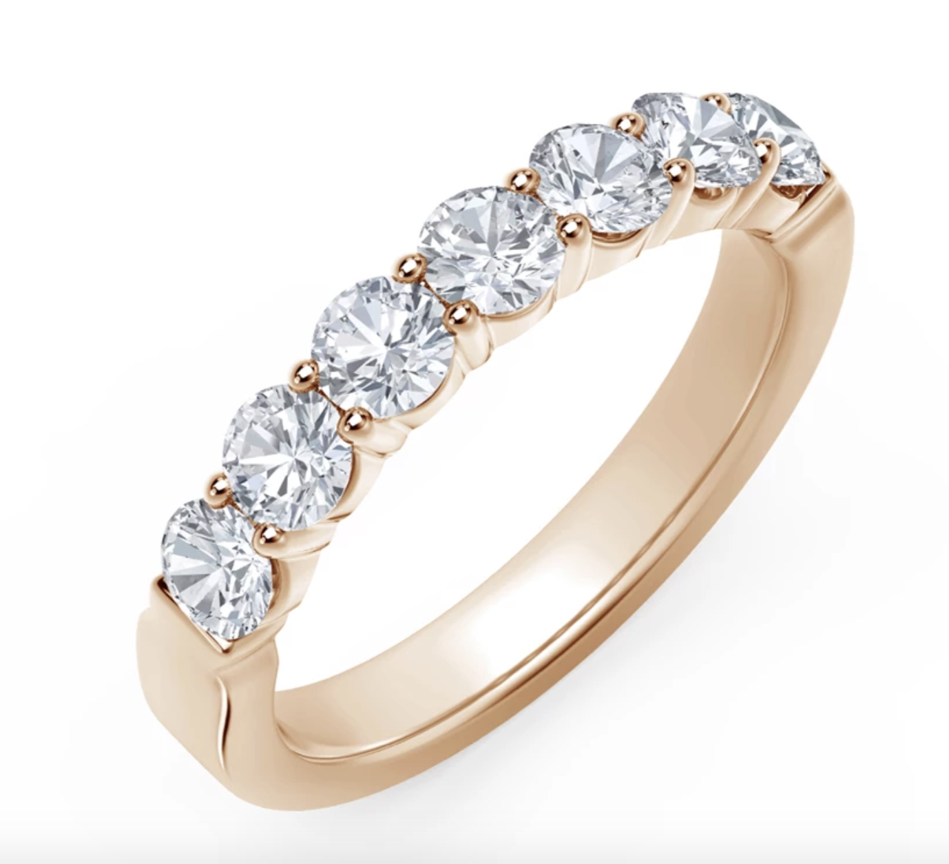 the gold band with seven circular diamonds