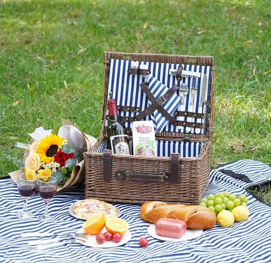 The picnic set with food and wine laying about