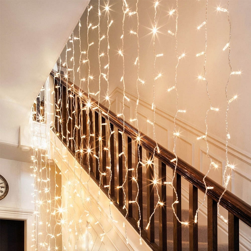 The string lights hung by the bannister
