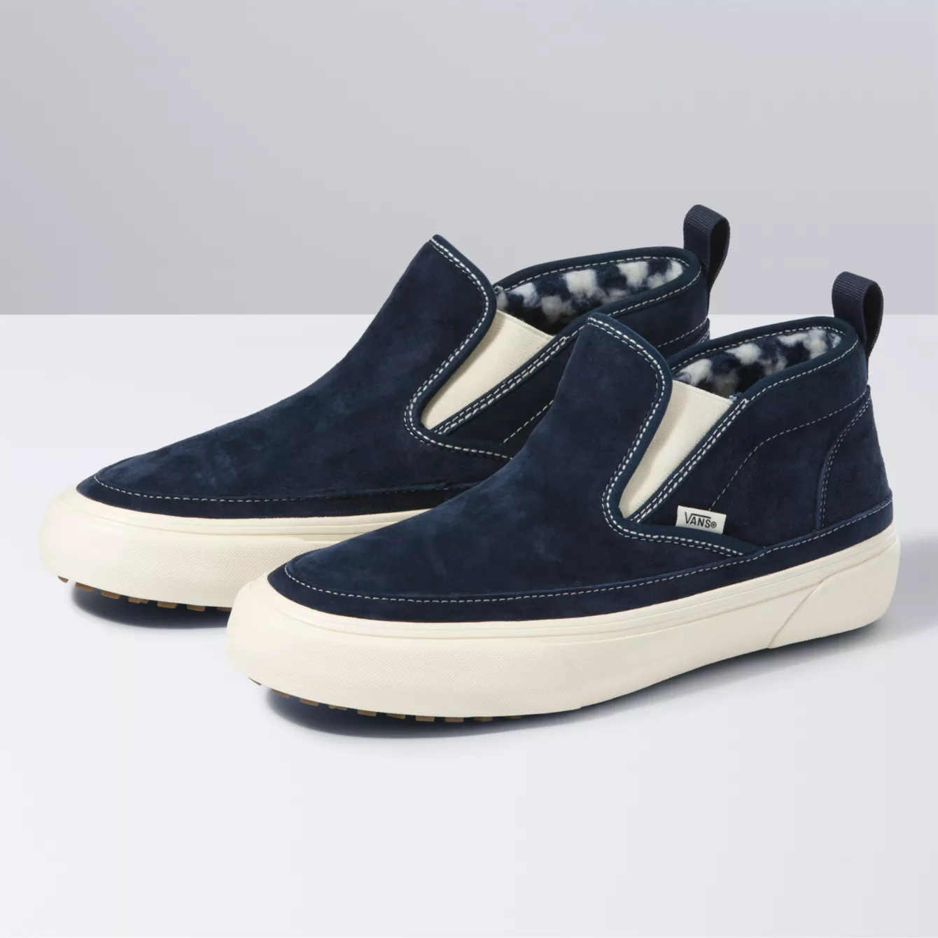 The suede sneakers in a midnight blue shade with white and blue furry lining