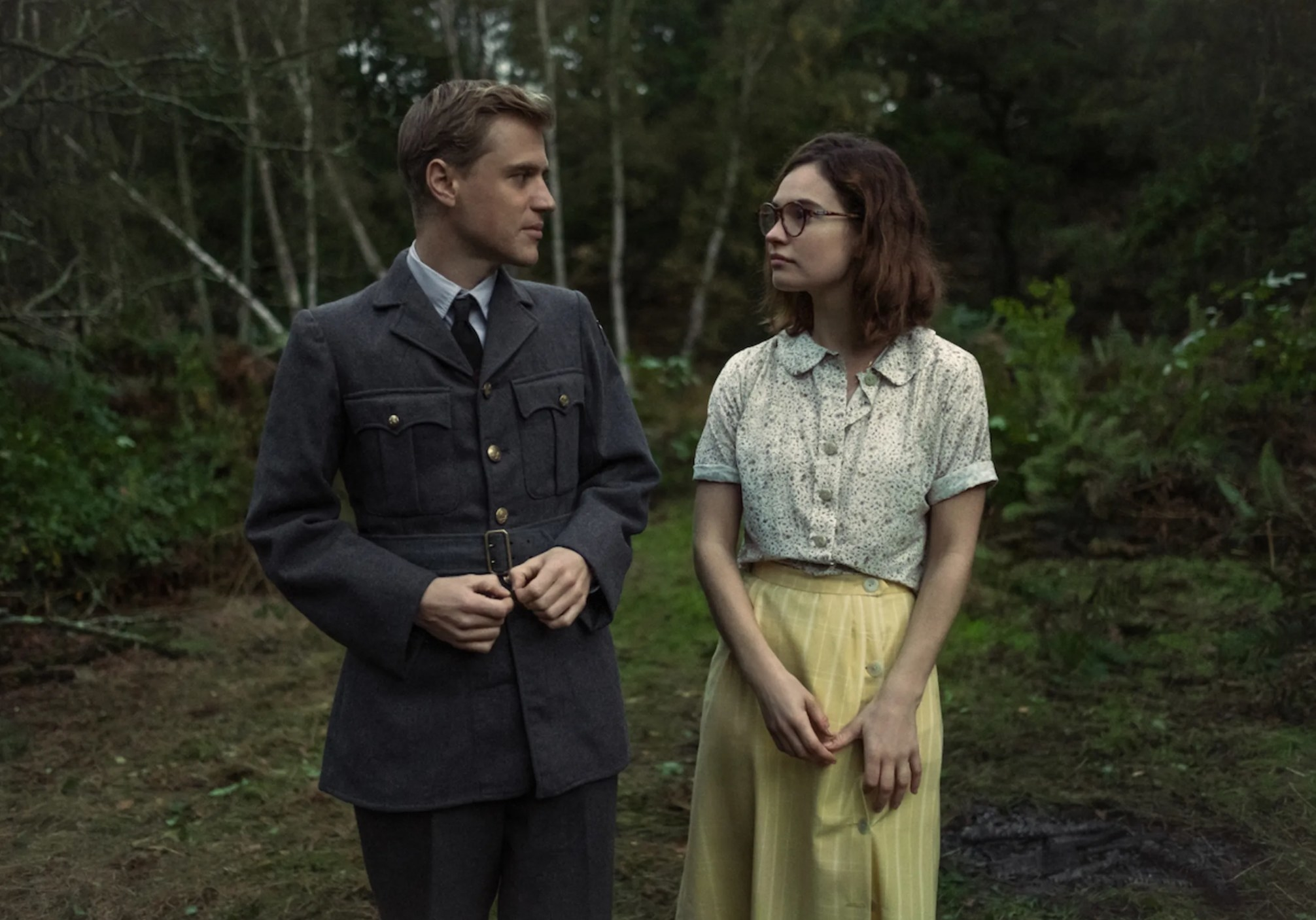 Still from The Dig: Peggy and Rory walking in a forest