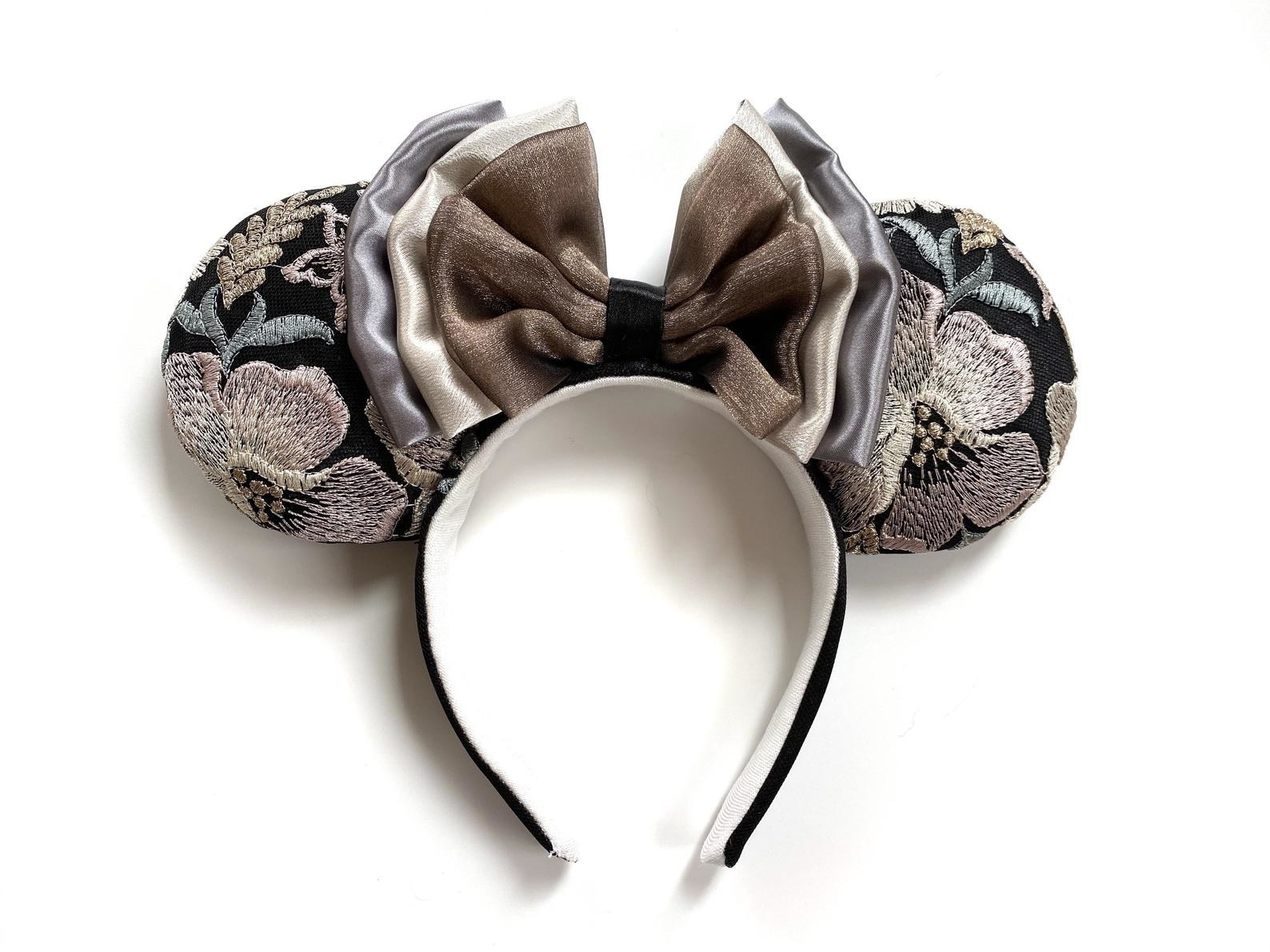 a pair of floral embroidered minnie mouse ears