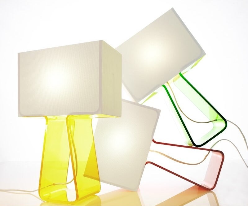 three tube top lamps of different colors displayed toppled on top of each other