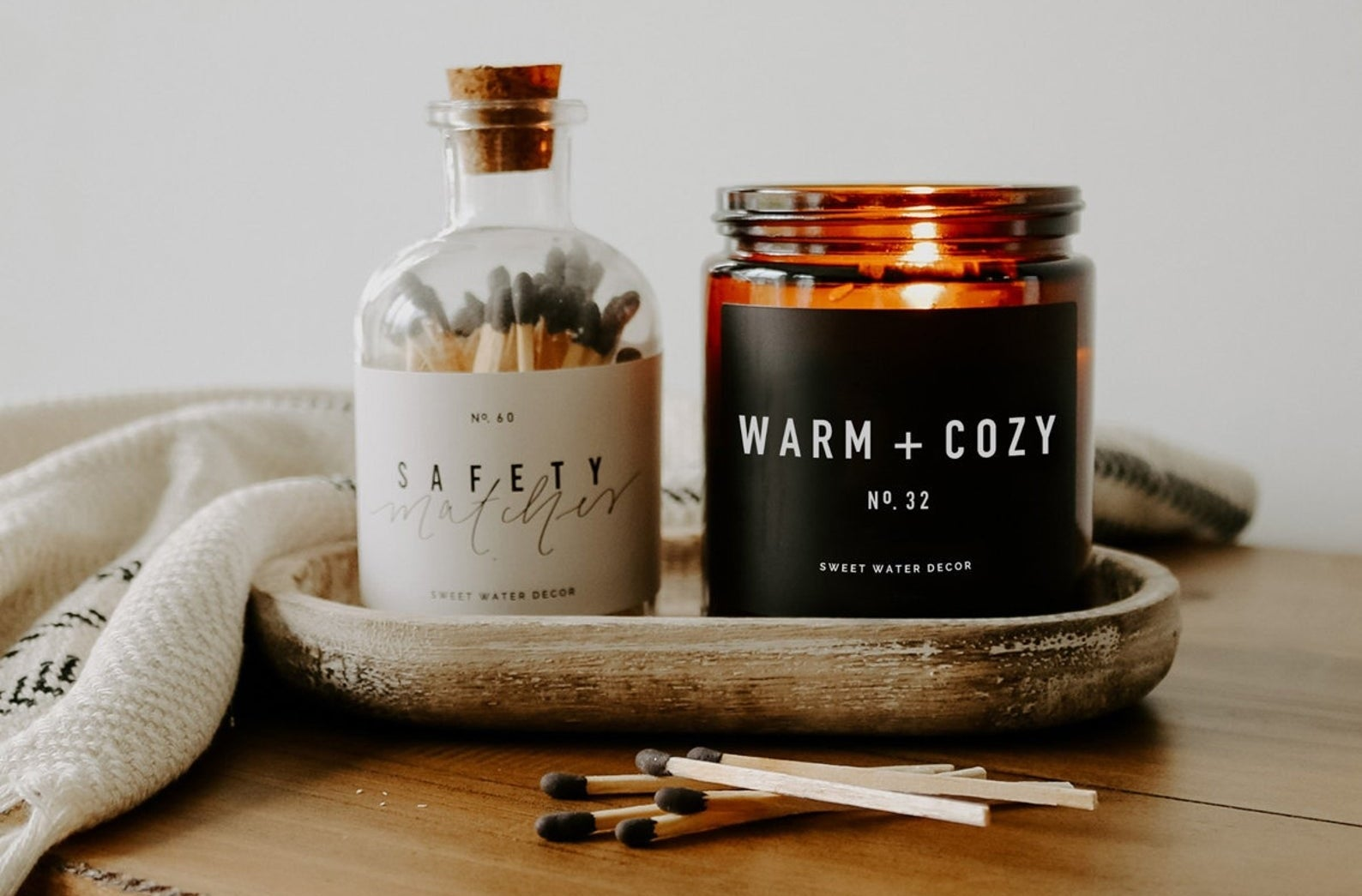 the lit warm and cozy candle
