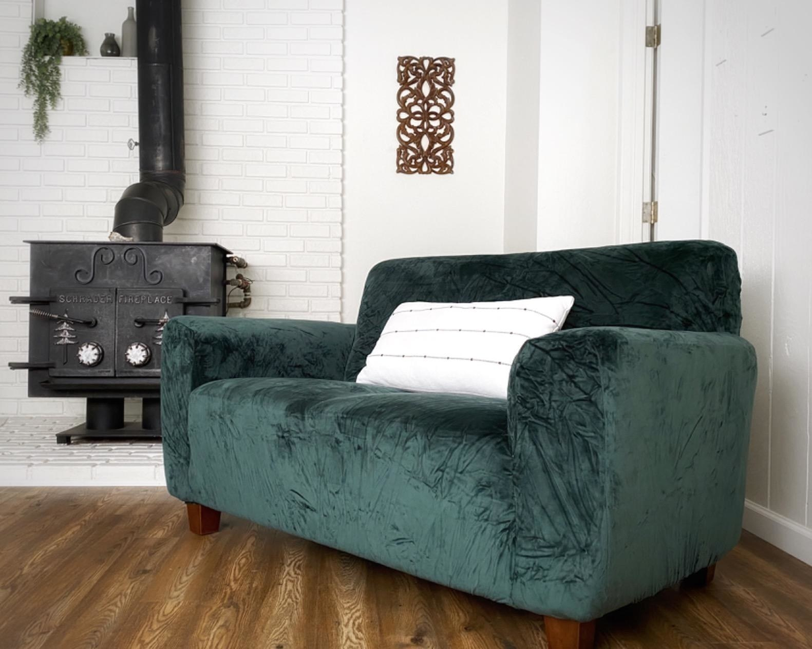A reviewer's sofa with the dark green cover