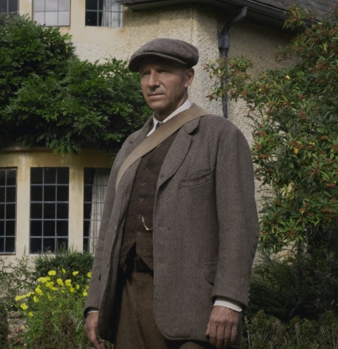 Still from The Dig: Basil Brown in front of a house