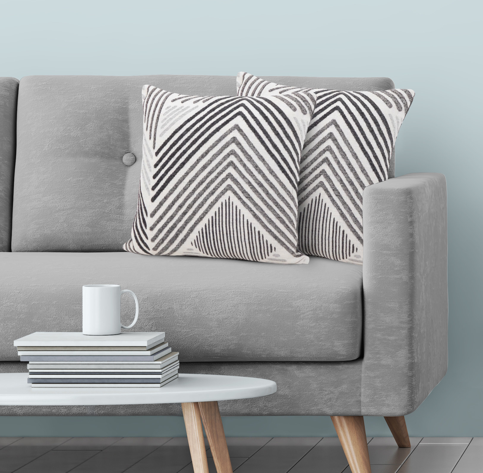 The pillows, which are small and square throw pillows, with a light gray base, and chevron stripe patterns in darker gray