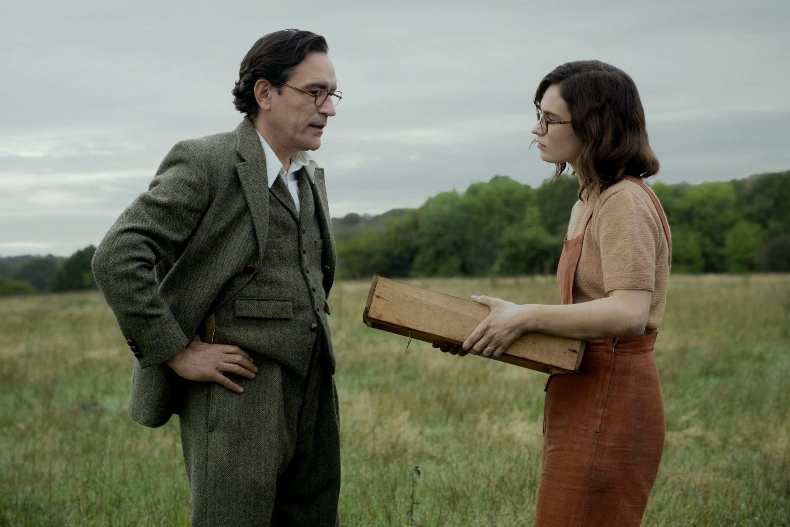 Still from The Dig: Peggy and husband in a field