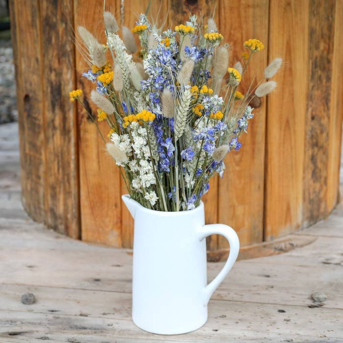 A blue, white, and yellow dried bouquet